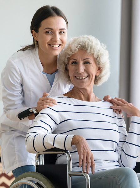 home carer with woman in wheelchair